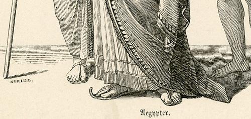 przedstawia władcę ze swoja świtą w starożytnych strojach.